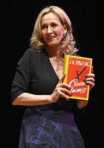 """Author J.K. Rowling poses for photographers with a copy of her adult fiction book """"The Casual Vacancy"""", at the Queen Elizabeth Hall in London"""